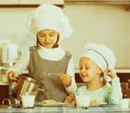 Girls having breakfast with porridge Stock Photo