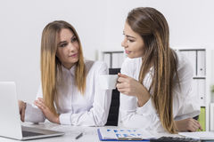 Girls having conversation with coffee Stock Image