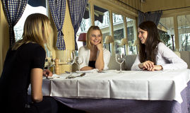 Girls having a dinner Stock Photography