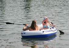 Girls having fun. Girls with boat having fun on a lake Stock Photos