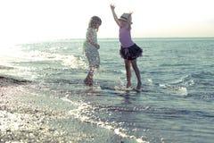 Girls having fun. Little girls having fun at the beach Royalty Free Stock Photo