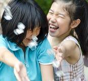 Girls having fun. 2 girls having fun with water splashing royalty free stock photo