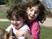 Girls having fun. These two young girls were having fun playing in the yard they seem to be very happy Stock Image