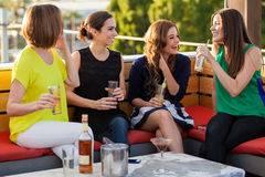 Girls having fun at a bar Royalty Free Stock Images
