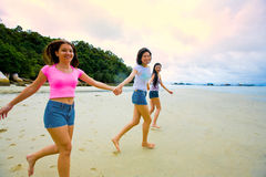 Girls having fun at the beach Stock Images
