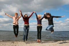 Girls having fun at the beach Stock Image
