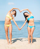 Girls having fun on the beach Stock Photography