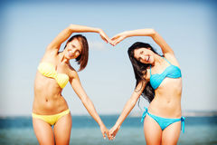 Girls having fun on the beach Royalty Free Stock Image