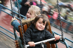 Girls having fun on the Carousel. Kids go round and round royalty free stock photo