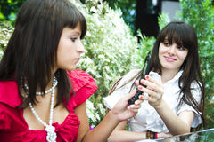 Girls having fun with cellphone Royalty Free Stock Images