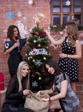 Girls are having fun. On Christmas eve with the presents royalty free stock photography