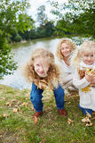 Girls having fun while collecting leaves Royalty Free Stock Photos