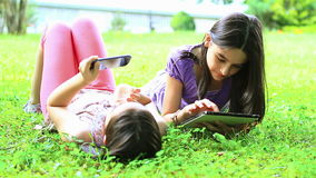 Girls having fun on digital tablet and smartphone stock video footage
