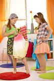 Girls having fun dressing up Stock Images