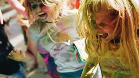 Girls having fun and jumping on the festival of Holi. Cool footage. Painted faces