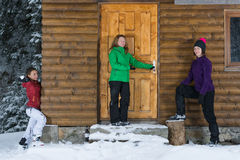 Girls having fun at a lodge in winter Stock Image