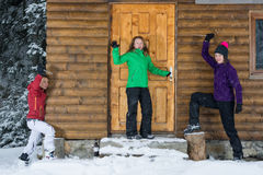 Girls having fun at a lodge in winter Stock Photos