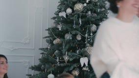 Girls having fun near Christmas tree stock video