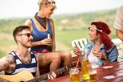 Girls having fun in open with good company, music, guitar and al Stock Photography