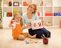 Girls having fun painting hands Stock Images