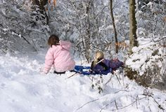 Girls having fun in the snow Stock Photos