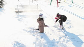 Girls having fun in snow. In a citypark stock video