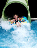 Girls having fun at waterpark. Image of girls on slide at waterpark Stock Photography
