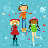 Girls Having Fun in Winter. Young female teenagers of different ethnics are smiling and happy. Girls enjoy falling colorful snowflakes. Winter background and Stock Images