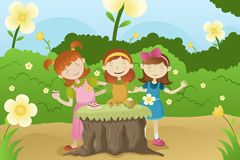 Girls having a garden party royalty free illustration