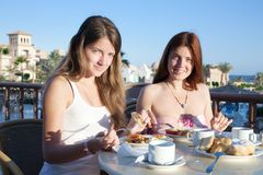 Girls having lunch Royalty Free Stock Image