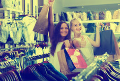 Girls having many shopping bags Stock Photography