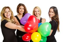 Girls having a party with baloons Stock Images