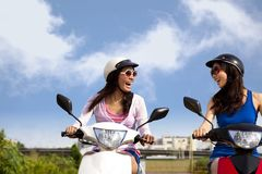 Girls having road trip on scooter Royalty Free Stock Photo