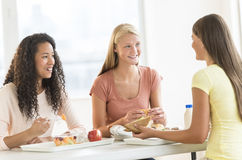 Girls Having Snacks In University Canteen Royalty Free Stock Photography