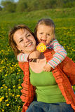Girls having some fun on the spring meadow Stock Photography