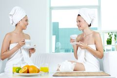 Girls having tea Royalty Free Stock Photos