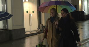 Girls having a walk and talk after shopping in the stock video footage