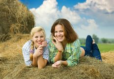Girls on  hay Stock Photos