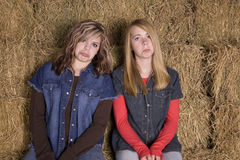 Girls on hay pouting Royalty Free Stock Photo