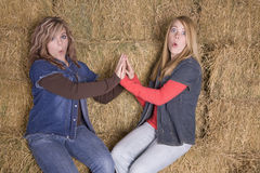 Girls on hay surprised Royalty Free Stock Images