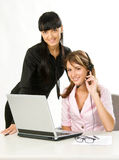 Girls with headset and laptop Royalty Free Stock Image