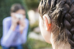 Girls with hearing problem Stock Photography