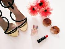 Girls heels accessories. Girls heels glasses red lipsitck royalty free stock photos