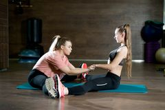 Girls help each other do stretching