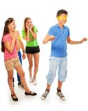 Girls hiding from boy with hidden eyes Stock Image