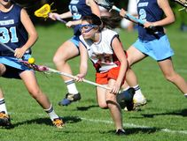 Girls High School Lacrosse. Girls High School Lacrosse team in game action in New Jersey stock photo