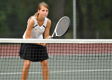 Girls High School Tennis. LITITZ, PA - SEPTEMBER 27: Unnamed girl's tennis player from Solanco High School waits at the net for a serve during a doubles match Stock Images