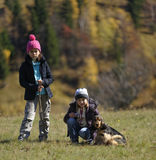 Girls hiking with dog Stock Photography