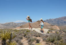 Girls hiking in the mountains. Royalty Free Stock Photo