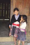 Girls of the Hmong flowered ethnic. Two Hmong girls flowers outside their house Stock Image